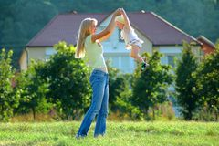 Mother plays with child stock photography