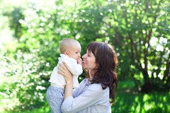 Mother plays with the child in park Stock Photo