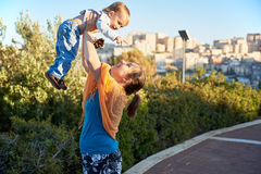 Mother plays with her little baby child outdoors Royalty Free Stock Photo