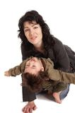 Mother plays with her little son. Young dark haired woman plays with her little son royalty free stock images