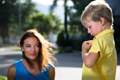 Mother plays with her son. Mother plays with her son in the park on the grass stock photo