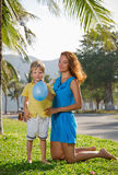 Mother plays with her son. Mother plays with her son in the park on the grass royalty free stock photos