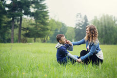 Mother plays with her son Stock Image