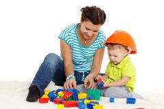 Mother plays with small baby. stock image