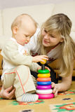 Mother plays with son Stock Photos