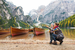 Mother pointing at scenery with daughter on shores of Lake Bries Royalty Free Stock Image