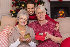 Mother posing with grandparents at christmas Royalty Free Stock Photography