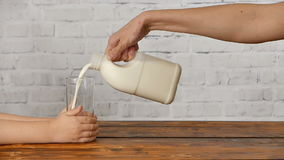 Mother pouring milk for breakfast her son stock video