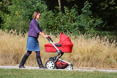 Mother and pram Royalty Free Stock Photography