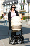Mother with pram Royalty Free Stock Images