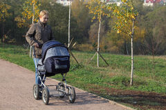 Mother with the pram Royalty Free Stock Images