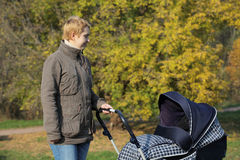 Mother with the pram royalty free stock photography