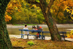 Mother with pram. Near the lake in the fall Stock Photos