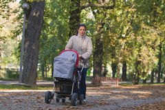 Mother with pram royalty free stock photography