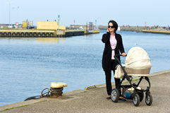 Mother with pram by sea Royalty Free Stock Images