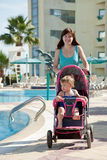 Mother with  pram  walking  at resort Royalty Free Stock Images