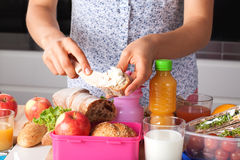 Free Mother Preaparing A Breakfast Stock Image - 34602691