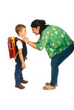 Mother prepare boy for school. Isolated on white background Royalty Free Stock Images