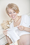 The mother prepares the baby Royalty Free Stock Image