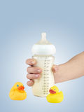 Mother prepares baby milk. Stock Images
