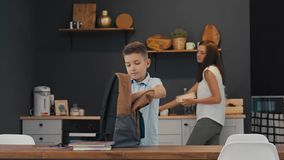 Mother prepares lunch for her son at school stock footage