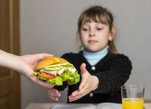 Mother prepares a sandwich for a child in school, schoolgirl, royalty free stock photo