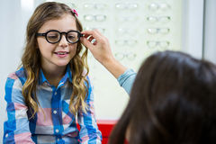 Mother prescribing spectacles to her daughter Stock Image