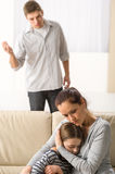 Mother protecting her daughter from angry father Royalty Free Stock Photography