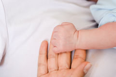 Mother protecting her newborn child Stock Photography