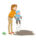 A mother pulled a dirty son of a puddle. Isolated color picture of puzzled mother, who pulled a dirty and happy son out of large puddle Stock Images