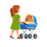 Mother pushing baby stroller walking with kid. Mother in dress pushing baby stroller. Babysitter woman walking with kid in blue pram. Mom child care concept Stock Photography