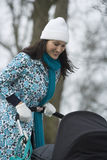 Mother Pushing Stroller In Park Royalty Free Stock Photo