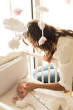 Mother putting baby to sleep Royalty Free Stock Photos