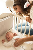 Mother putting baby to sleep Royalty Free Stock Photography