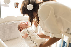 Mother putting baby to sleep Royalty Free Stock Photo