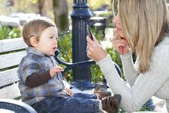 Mother putting on Make Up and Baby Boy on Street Royalty Free Stock Photography