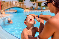 Mother putting sunscreen on her sons face Royalty Free Stock Images