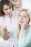 Mother Questioning Teenage Daughter About Pregnancy Test Stock Photo
