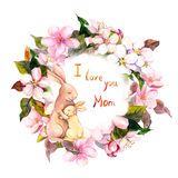 Mother rabbit hugging her baby in floral wreath. Greeting card for Mothers day. Watercolor Royalty Free Stock Images
