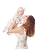 Mother raises her daughter in her arms. Isolated. Royalty Free Stock Photo