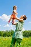 Mother raising baby Stock Image