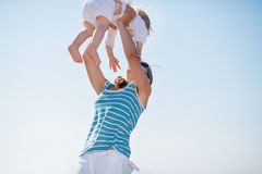 Mother raising baby in sky Royalty Free Stock Image