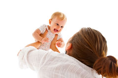 Mother raising her baby Royalty Free Stock Image