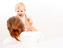 Mother raising her baby Royalty Free Stock Images