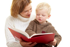 Mother reading aloud Stock Images