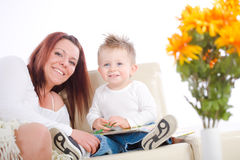 Mother reading for baby Stock Images