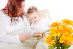 Mother reading for baby Royalty Free Stock Photos