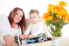 Mother reading for baby Royalty Free Stock Image