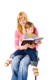 Mother reading book Stock Images