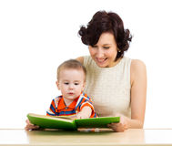 Happy mother reading a book baby boy Stock Images